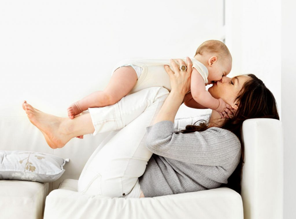 Mother on couch with child